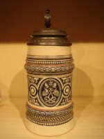 stein with ornate pewter lid