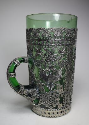 Green pouring glass with detailed filigree work