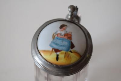 Glass child's stein with porcelain inlaid lid