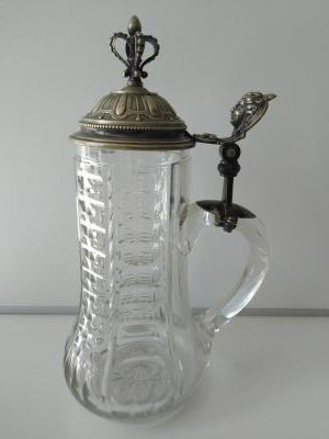 cut glass stein with ornate silvered lid